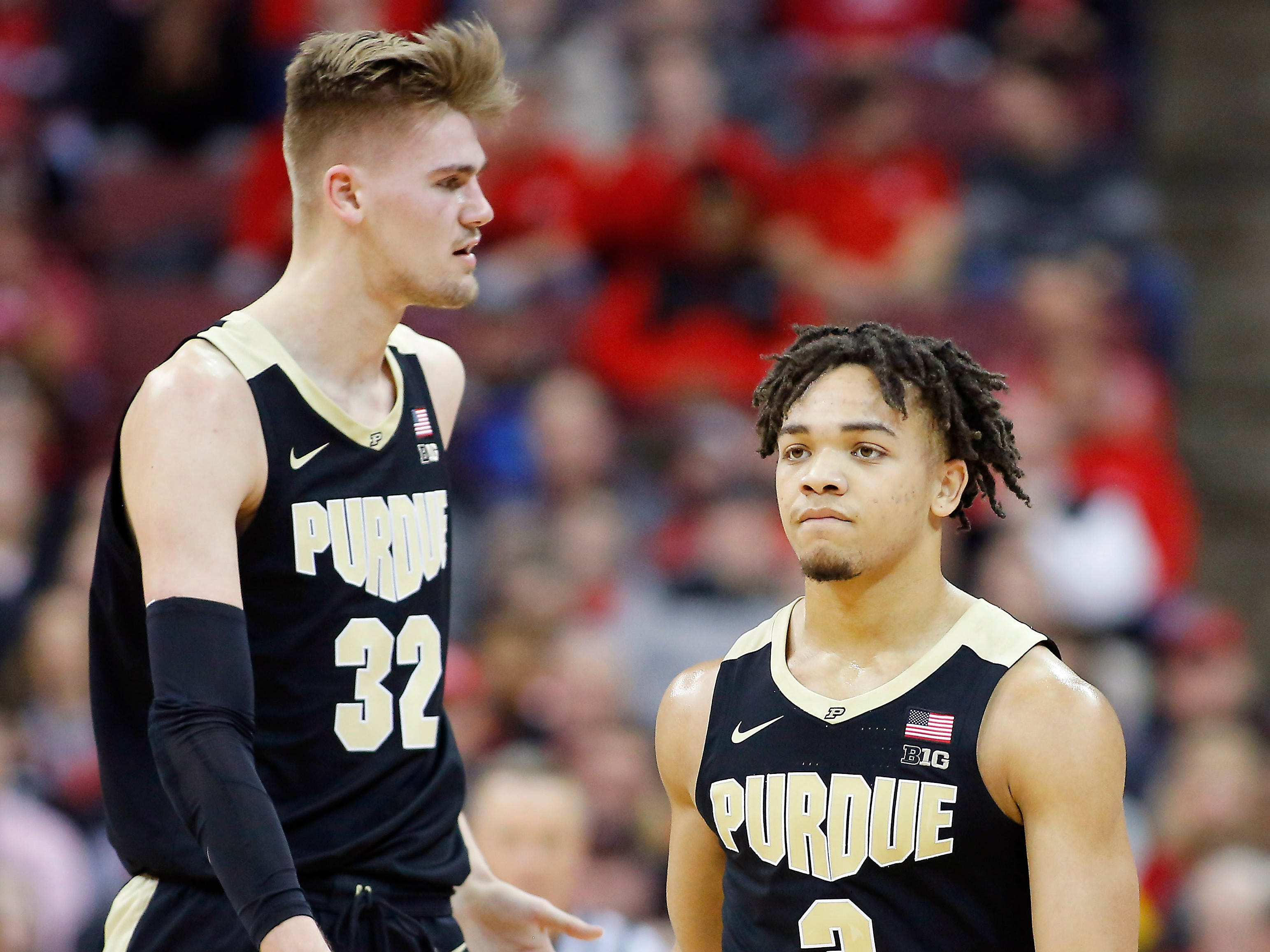 Jan 23, 2019; Columbus, OH, USA; Purdue Boilermakers guard Carsen Edwards (3) and Boilermakers center Matt Haarms (32) celebrate during the first half against the Ohio State Buckeyes at Value City Arena. Mandatory Credit: Joe Maiorana-USA TODAY Sports
