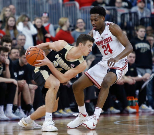 Purdue's Grady Eifert, left, keeps the ball from Ohio State's Andre Wesson during the second half of an NCAA college basketball game Wednesday, Jan. 23, 2019, in Columbus, Ohio. Purdue won 79-67.