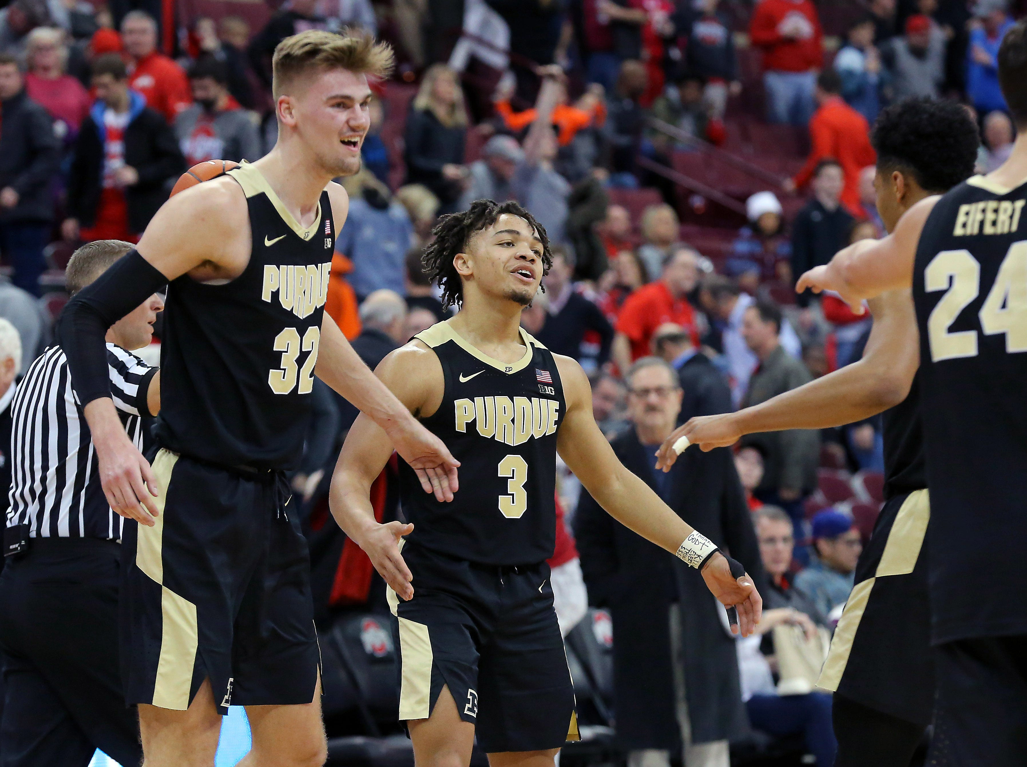 Jan 23, 2019; Columbus, OH, USA; Purdue Boilermakers guard Carsen Edwards (3) and center Matt Haarms (32) celebrate as time winds down against the Ohio State Buckeyes at Value City Arena. Mandatory Credit: Joe Maiorana-USA TODAY Sports