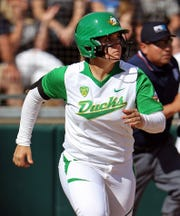 UL softball volunteer assistant coach Geri Ann Glasco, pictured here hitting her third home run of a game against Washington for the Oregon Ducks in 2015, tragically died in an automobile accident early Thursday morning in I-10.