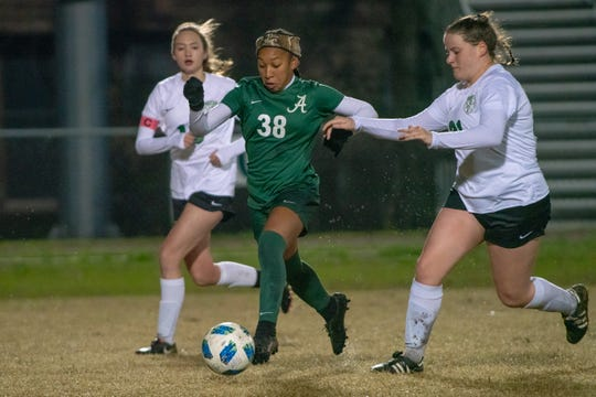 Acadiana High's Rammie Noel (38) maintains control of the ball while running down the field as the Acadiana Wreckin' Rams take on the Lafayette High Lions at Bill Dotson Stadium on Jan. 23, 2019.