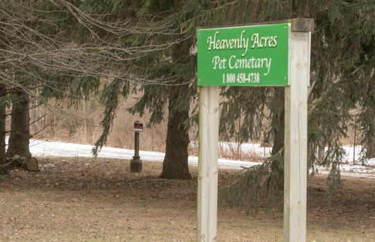 """""""No trespassing"""" signs are posted on the property of Heavenly Acres Pet Cemetery on S. Kellogg Rd. in Genoa Township, shown Thursday, Jan. 24, 2019."""