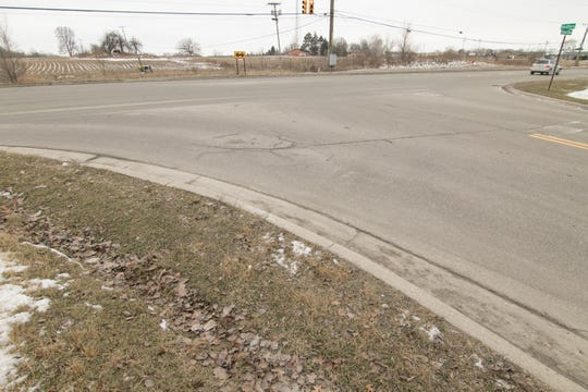 A sidewalk and crosswalk will be installed at the intersection of Grand River Ave. and Hughes Road in Genoa Township, shown Thursday, Jan. 24, 2019.