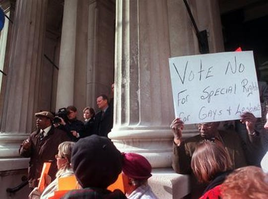Opponents rally outside city hall before the 1999 vote.