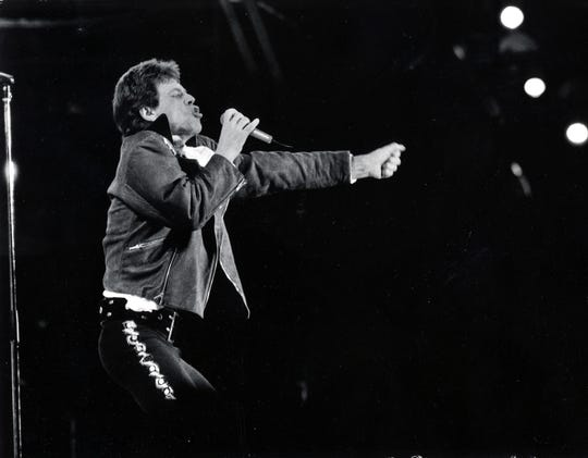 Mick Jagger leads the Rolling Stones through a 1989 show at Old Cardinal Stadium.