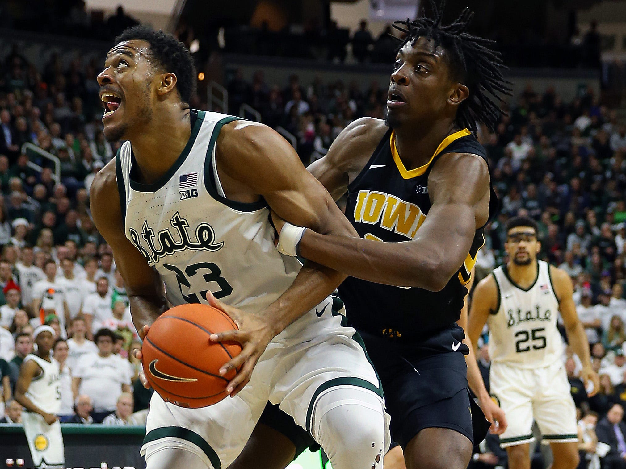 Dec 3, 2018; East Lansing, MI, USA; Michigan State Spartans forward Xavier Tillman (23) is fouled by Iowa Hawkeyes forward Tyler Cook (25) during the second half of a game at Breslin Center. Mandatory Credit: Mike Carter-USA TODAY Sports