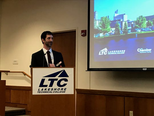 Jim Lemerond, vice president of instruction for LTC, watches as the lease for the new Manitowoc LTC campus at 600 York Street is signed and finalized Jan. 24, 2019.