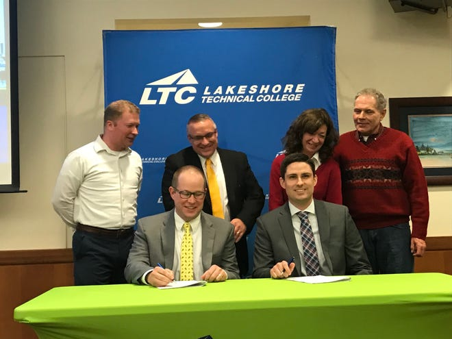 Back row, from left: Manitowoc Mayor Justin Nickels, Progress Lakeshore Executive Director Peter Wills, Chamber of Manitowoc County Executive Director Karen Nichols and LTC Board Chair John Lukas watch as (front row, from left) LTC President Dr. Paul Carlsen and real estate developer Alex Allie sign the lease agreement for the new LTC Manitowoc Campus at 600 York Street.