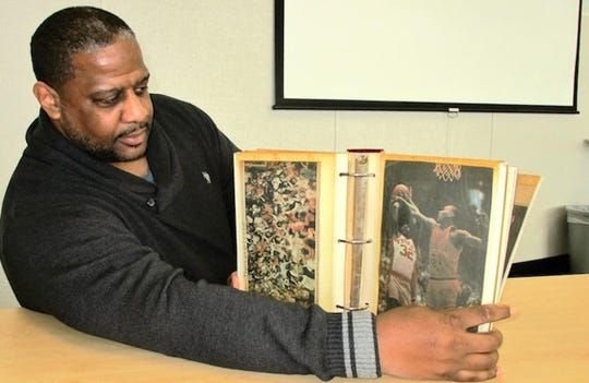 Effie James displays a scrapbook of newspaper clippings from the Tygers' run to the 1985 basketball state title game.  James has made a documentary on that magical season that will be part of a free presentation on Saturday, Feb. 2 at 5 p.m. at Mansfield Senior.
