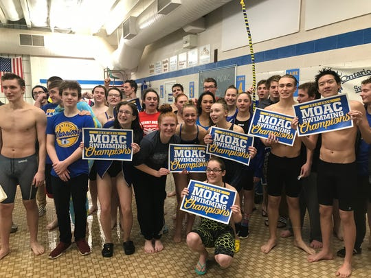 The Ontario boys and girls teams celebrate their title sweep in Wednesday's Mid-Ohio Athletic Conference swim meet.