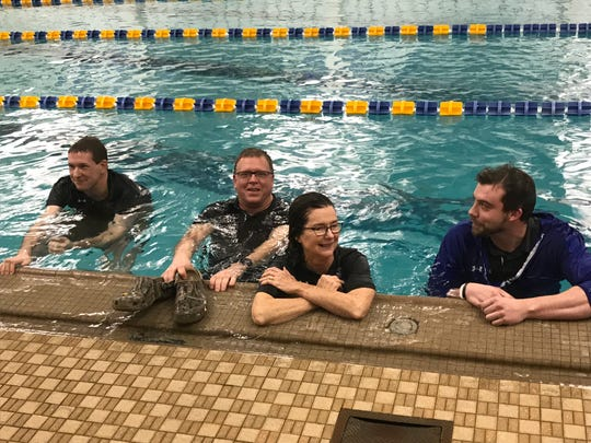 Taking a celebratory plunge after Ontario swept the boys and girls titles in Wednesday's Mid-Ohio Athletic Conference swim meet were, left to right, coaches Travis Fisher, Keith Wright and Debby Henry, along with athletic director Michael Grist.