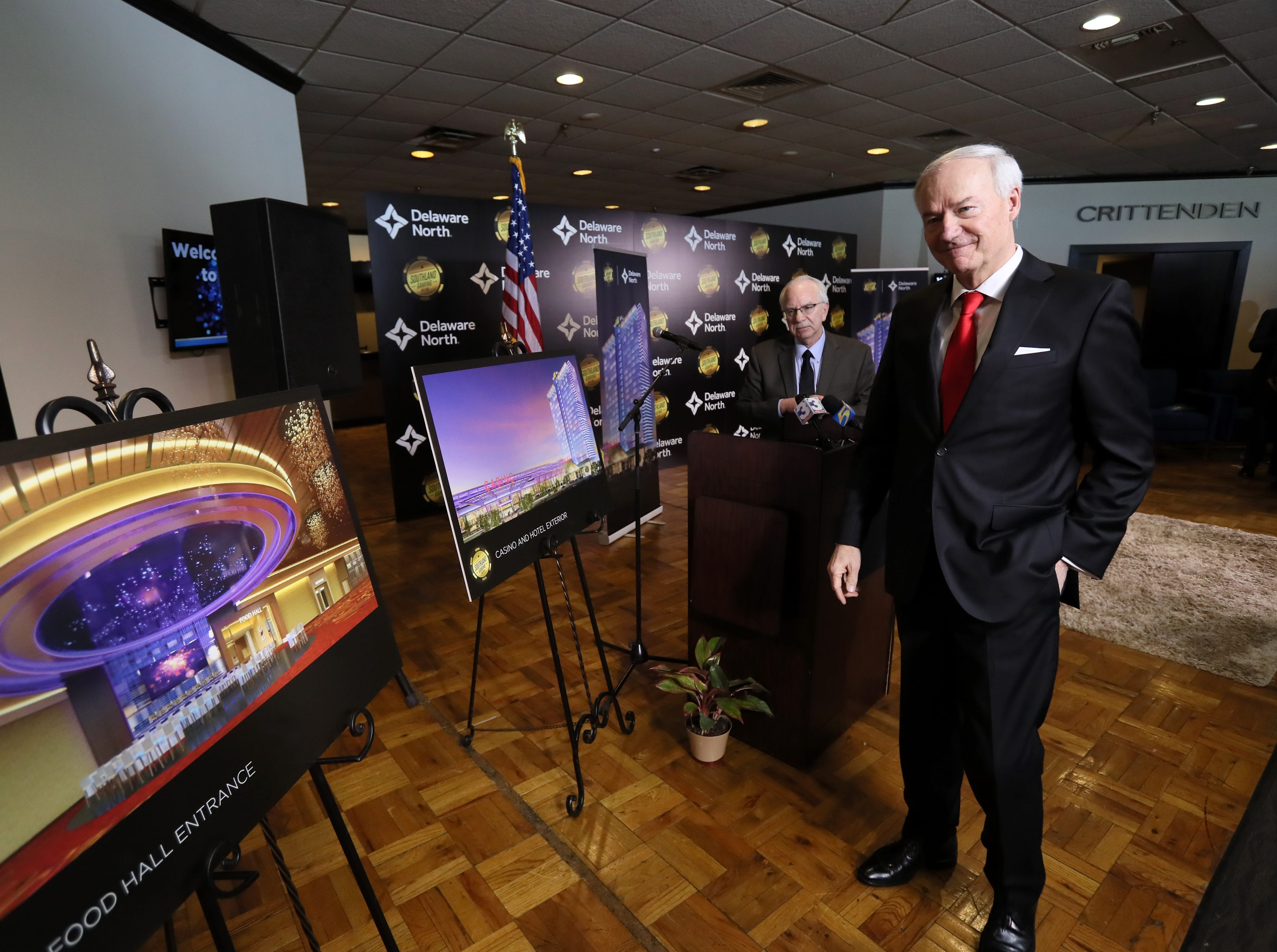 Arkansas Gov. Asa Hutchinson previews the designs of hospitality company Delaware North as they make an announcement of their $250 million expansion of Southland Gaming & Racing in West Memphis on Thursday, Jan. 24, 2019.