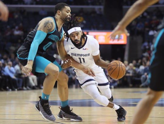 Memphis Grizzlies guard Mike Conley drives past Charlotte Hornets forward Miles Bridges during their game at the FedExForum on Wednesday, Jan. 23, 2019.
