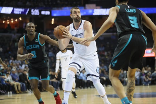 Memphis Grizzlies center Marc Gasol looks to pass the ball against he defense of Charlotte Hornets guard Jeremy Lamb, right, and center Bismack Biyombo during their game at the FedExForum on Wednesday, Jan. 23, 2019.