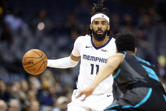 Memphis Grizzlies guard Mike Conley looks to drive past Charlotte Hornets forward Nicolas Batum during their game at the FedExForum on Wednesday, Jan. 23, 2019.