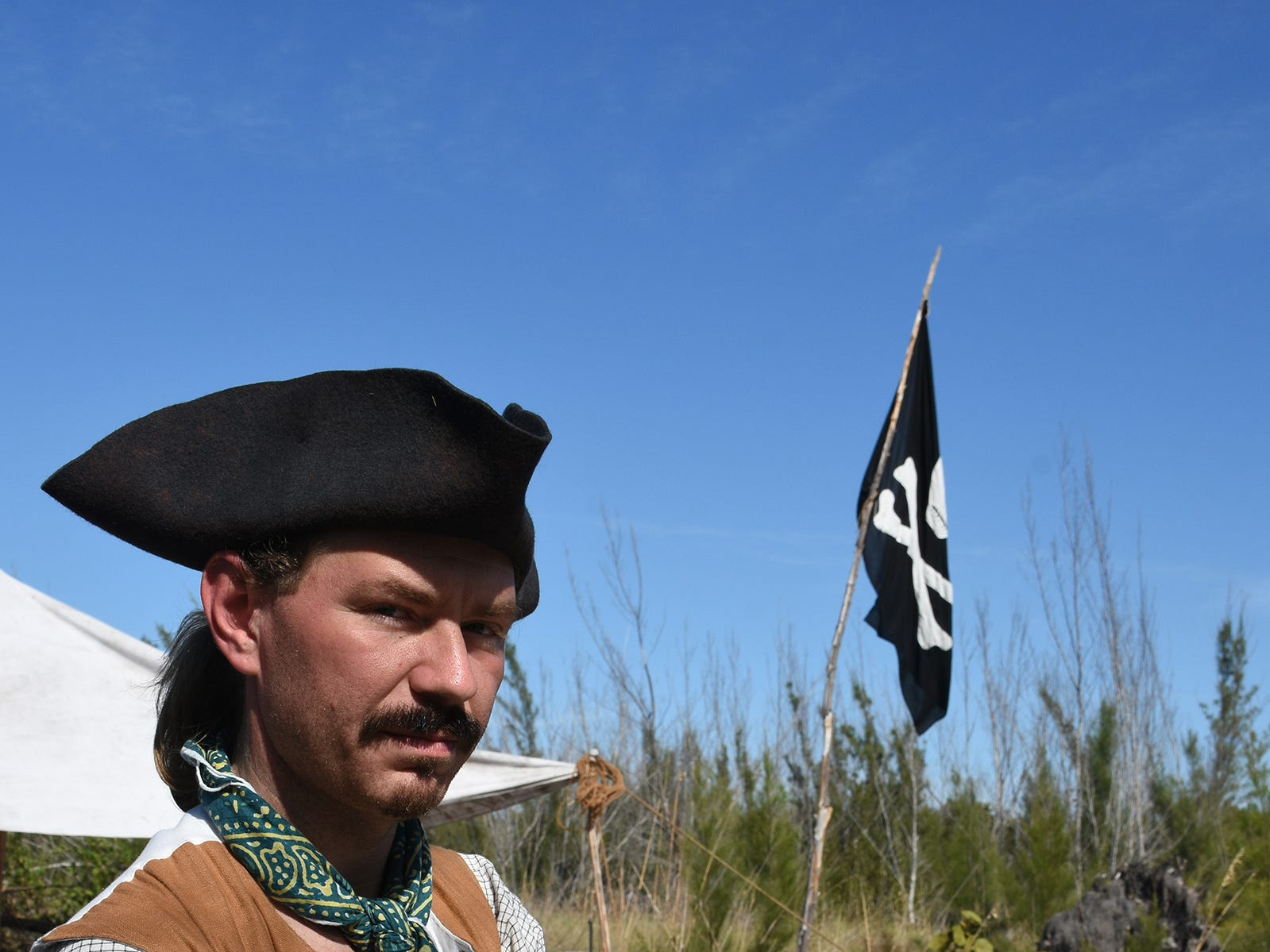 Donald Ridenbaugh, aka Capt. Jack Sawford, relaxes in camp. A group of historical reenactors dedicated to living the life of 18th century swashbucklers set up a pirate camp on Kice Island, across Caxambas Pass from Cape Marco, over the weekend.