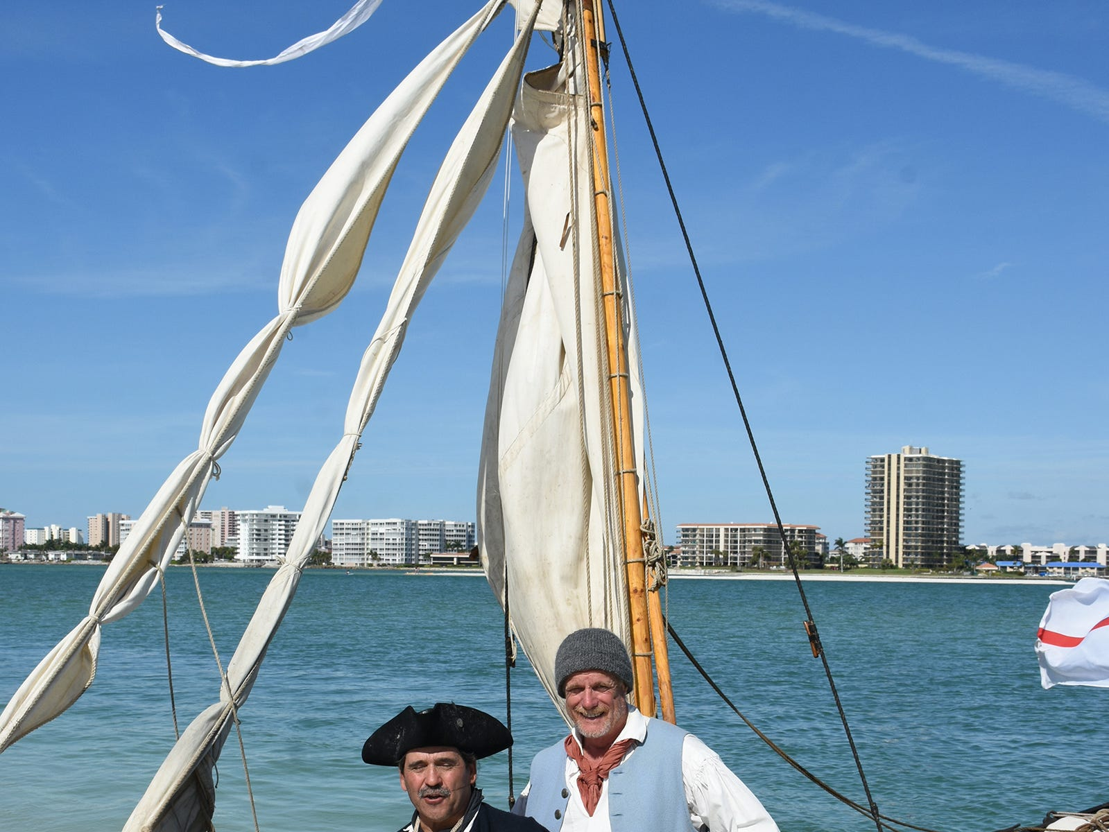 Capt. Scott Padeni and Bob Cifrino with the gunboat Gen. Arnold. A group of historical reenactors dedicated to living the life of 18th century swashbucklers set up a pirate camp on Kice Island, across Caxambas Pass from Cape Marco, over the weekend.