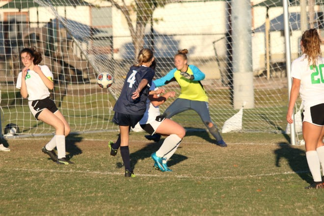 Marco Island Academy sophomore Hailey Cartwright scores one of her two goals in the Manta Rays' 4-0 victory over Donohue Academy in the Paradise Coast Athletic Conference championship game Monday.