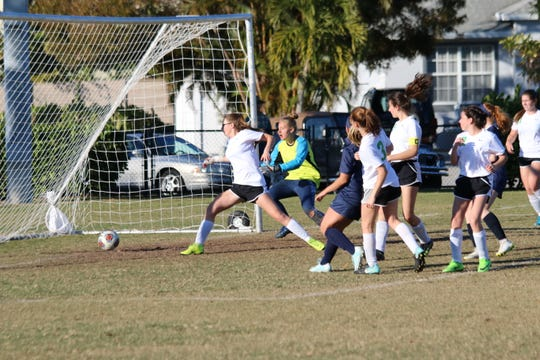 Marco Island Academy senior Teagan Havemeier scores a goal in the Paradise Coast Athletic Conference title game against Donohue Academy. The Manta Rays won, 4-0.