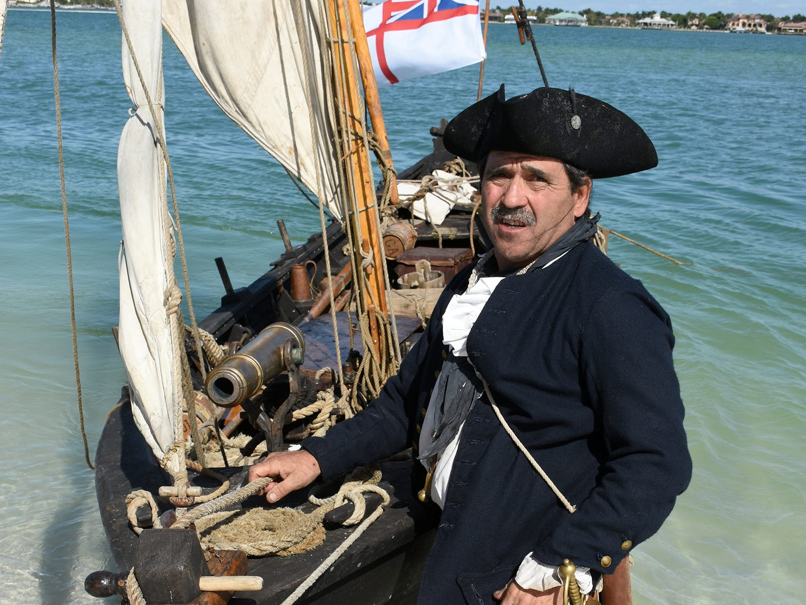 Capt. Scott Padeni with the gunboat Gen. Arnold, which he built by hand. A group of historical reenactors dedicated to living the life of 18th century swashbucklers set up a pirate camp on Kice Island, across Caxambas Pass from Cape Marco, over the weekend.