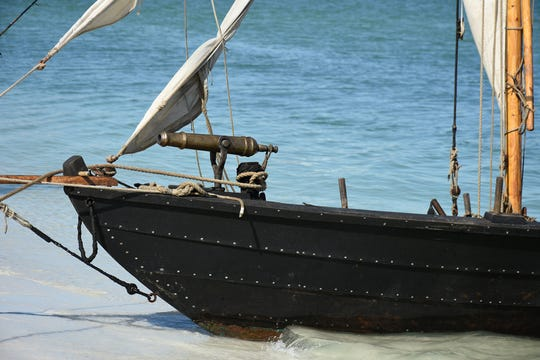 Capt. Scott Padeni built the gunboat Gen. Arnold, equipped with a brass swivel gun, by hand. A group of historical reenactors dedicated to living the life of 18th century swashbucklers set up a pirate camp on Kice Island, across Caxambas Pass from Cape Marco, over the weekend.