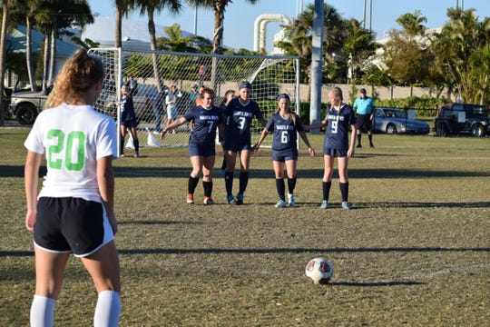 Marco Island's Lauren Faremouth, Anna Chamberlin, Teagan Havemeier and Jillian Cartwright line up to defend a free kick during the Manta Rays' 4-0 win over Donohue Academy in the Paradise Coast Athletic Conference championship game Monday.