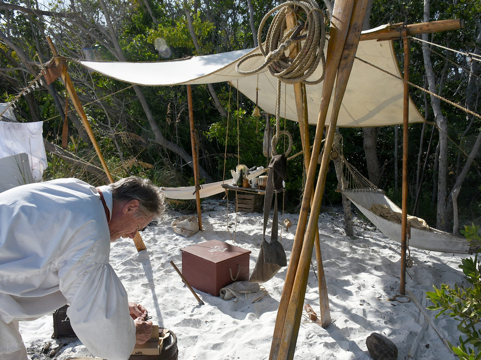 Bob Cefrino tends to his period-authentic campsite, with nothing modern (except a cell phone and car keys stashed away). A group of historical reenactors dedicated to living the life of 18th century swashbucklers set up a pirate camp on Kice Island over the weekend.
