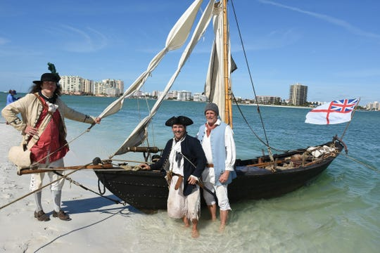 Sean Wallis, from left, Capt. Scott Padeni and Bob Cifrino with the gunboat Gen. Arnold. A group of historical reenactors dedicated to living the life of 18th century swashbucklers set up a pirate camp on Kice Island, across Caxambas Pass from Cape Marco, over the weekend.