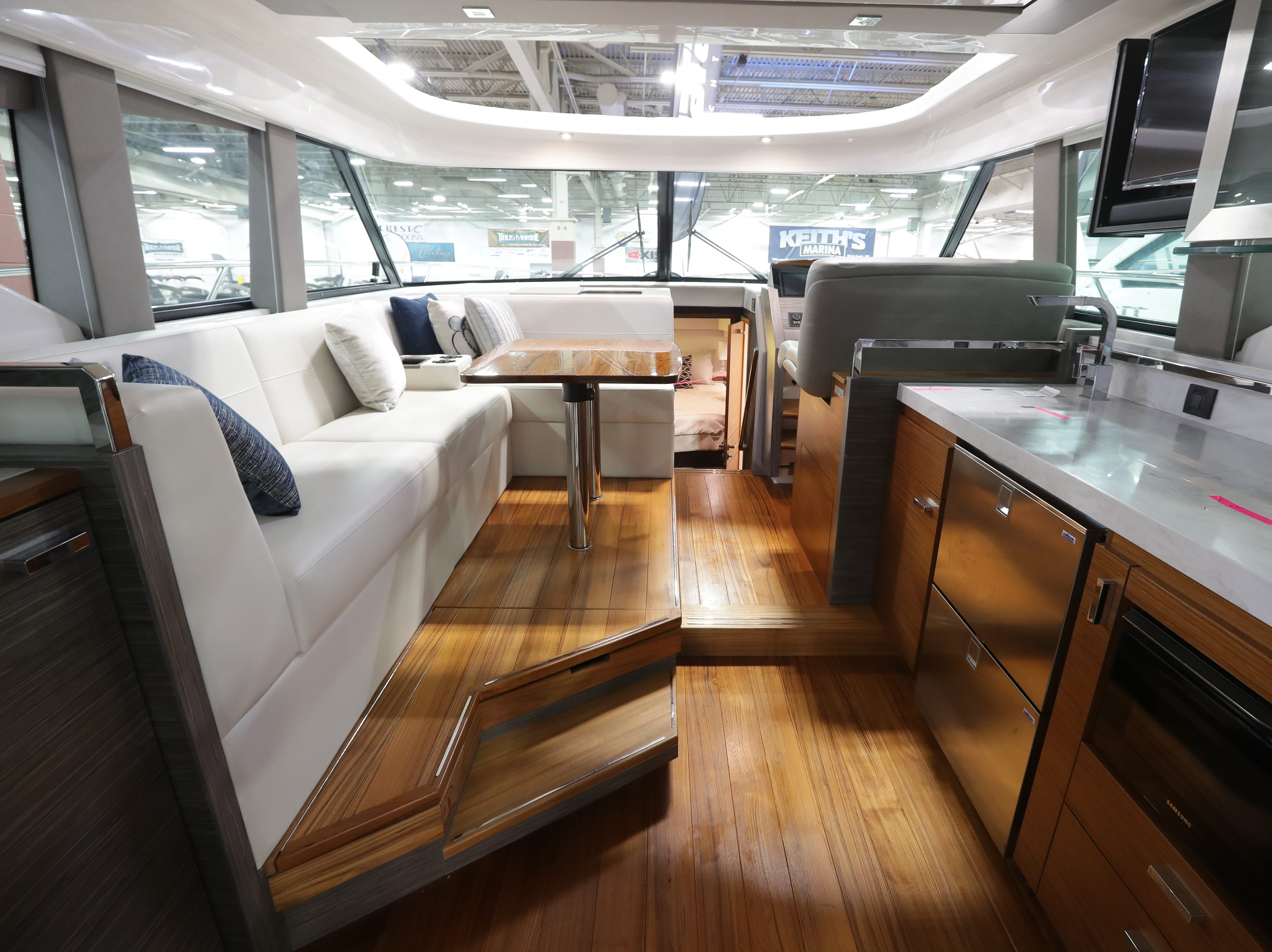 This 2019 44-foot Tiara yacht, which lists for  $1,205,682, features a large upper seating area and a kitchen.