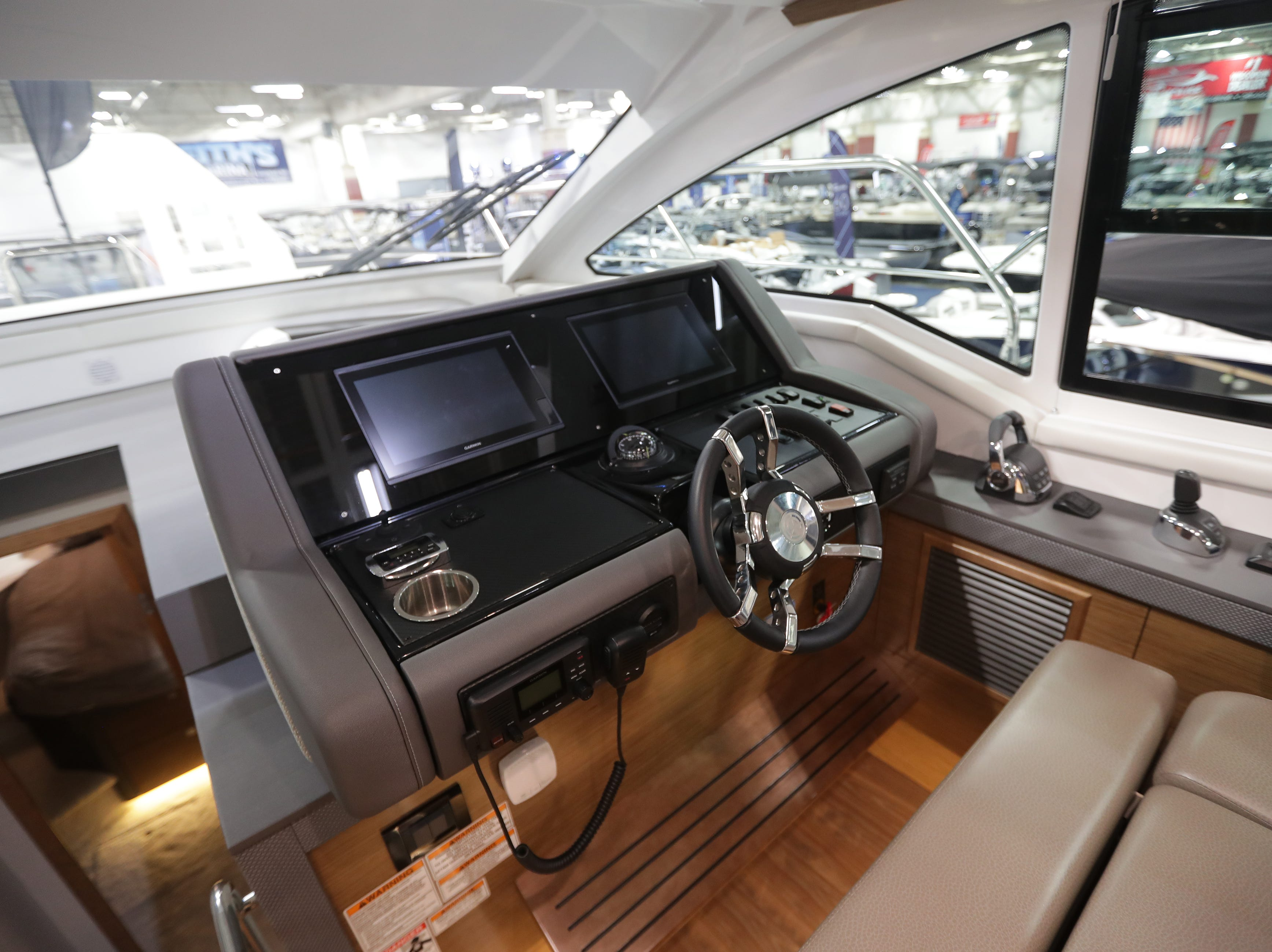 The helm of a 2019 42-foot Cruisers Cantius yacht, which lists for $1,022,244.