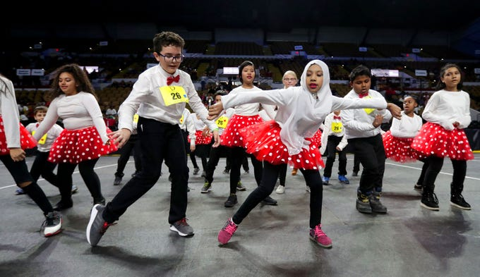 St. Martini Lutheran School fifth-graders  Giovani Sanchez (left) and Husnara Karimullah, both 11, perform a hip=hop dance during the Danceworks Mad Hot competition at UW-Milwaukee Panther Arena in Milwaukee on Thursday. The dance event included more than 1,000 fourth- and fifth-grade students from 38 Milwaukee area schools competing in Latin and swing styles of tap dance. And new this year, students also competed in hip-hop dance in addition to traditional tap dance.