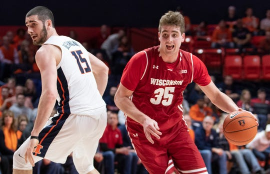 Nate Reuvers moves the ball around Illinois forward Giorgi Bezhanishvili on Wednesday night.