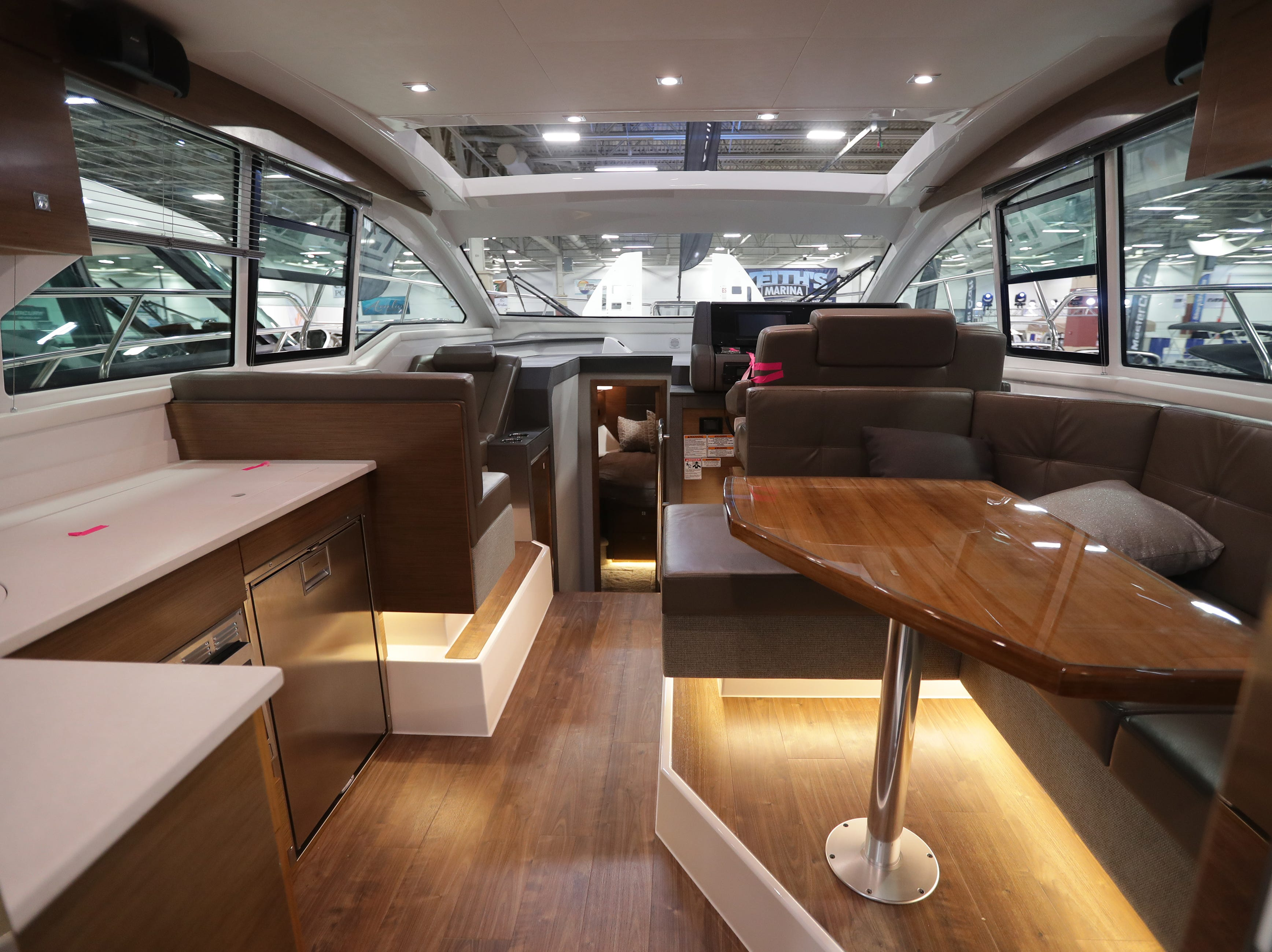 The main interior seating and dining area of a 2019 42-foot Cruisers Cantius yacht, which lists for $1,022,244.