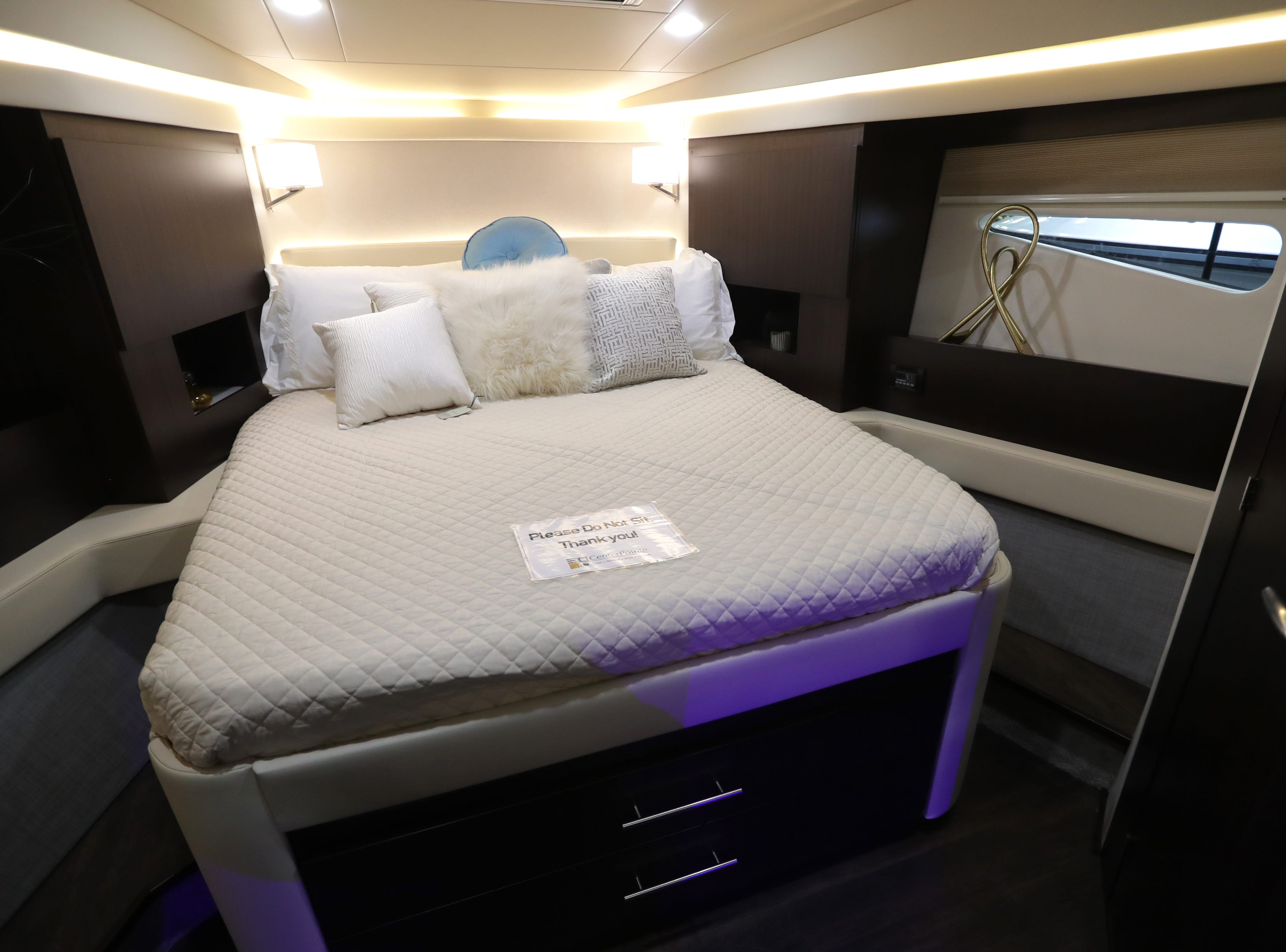 The master bedroom of a 42-foot Regal Grande Coupe yacht.