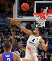 A shot just eludes the block attempt Marquette forward Theo John during the first half of the Golden Eagles' game against DePaul on Wednesday night at Fiserv Forum.