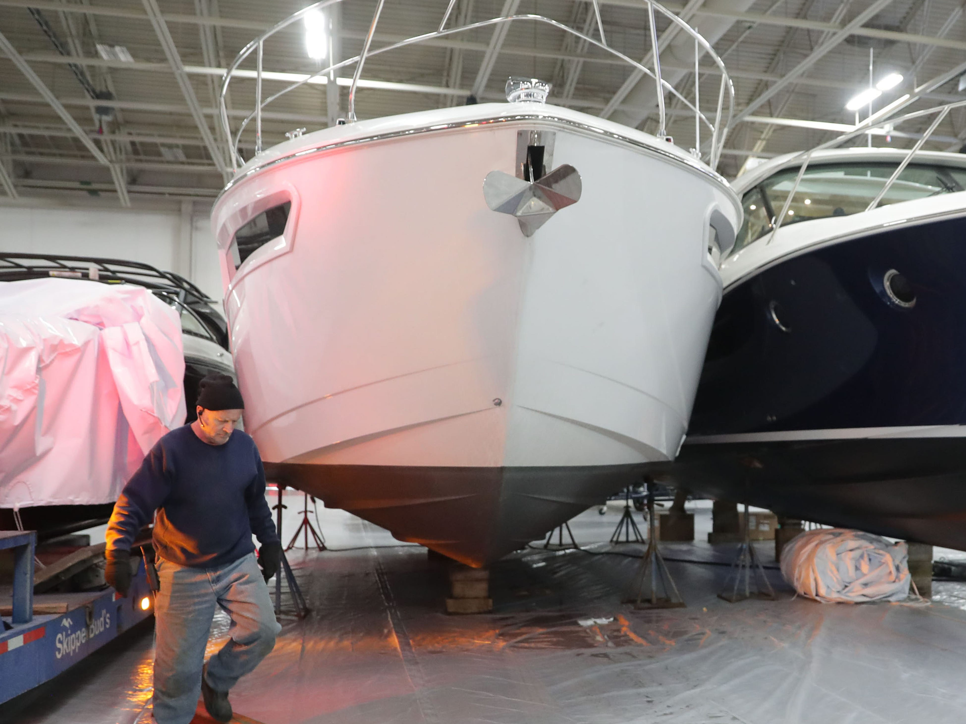 Mike McPherson with Skipper Buds, out of Pewaukee, works near this 2019 42-foot Cruisers Cantius yacht, with a price of $1,022,244.