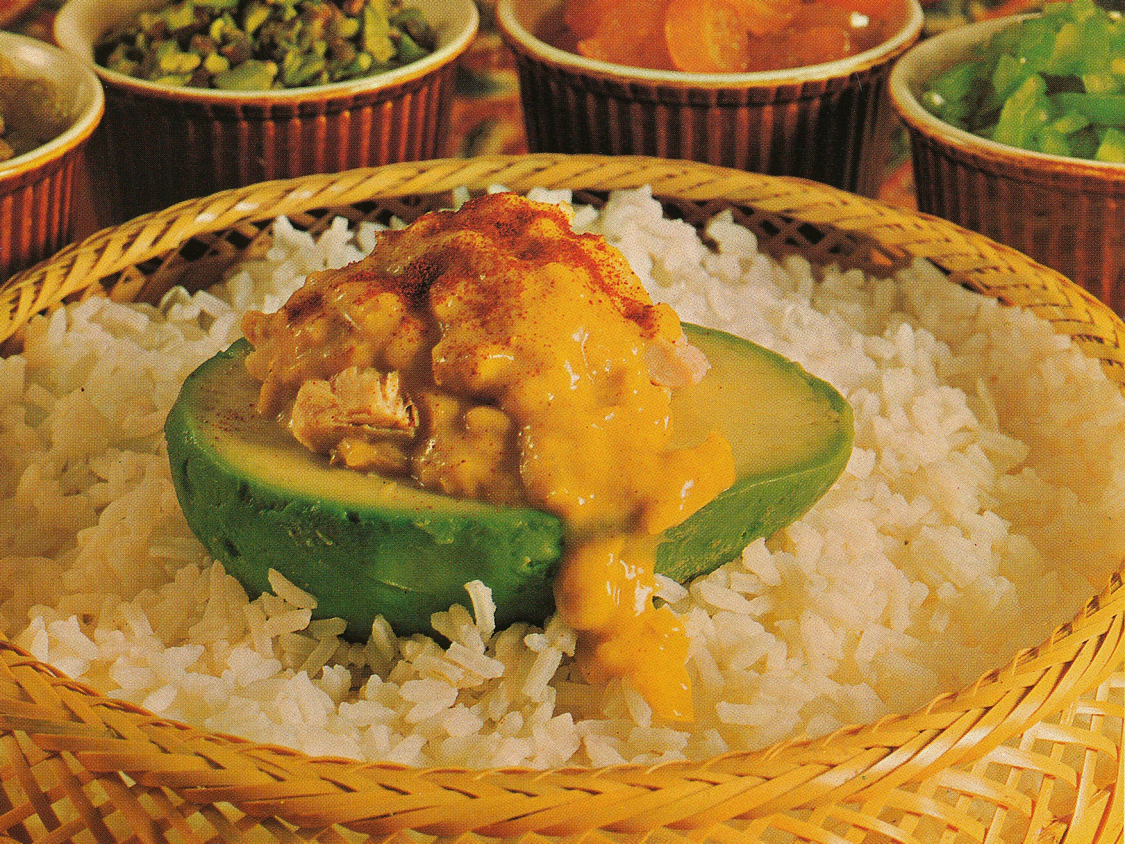 Peeled avocado halves were stuffed with curried chicken in this promotional recipe called Avocados on the Half Shell.