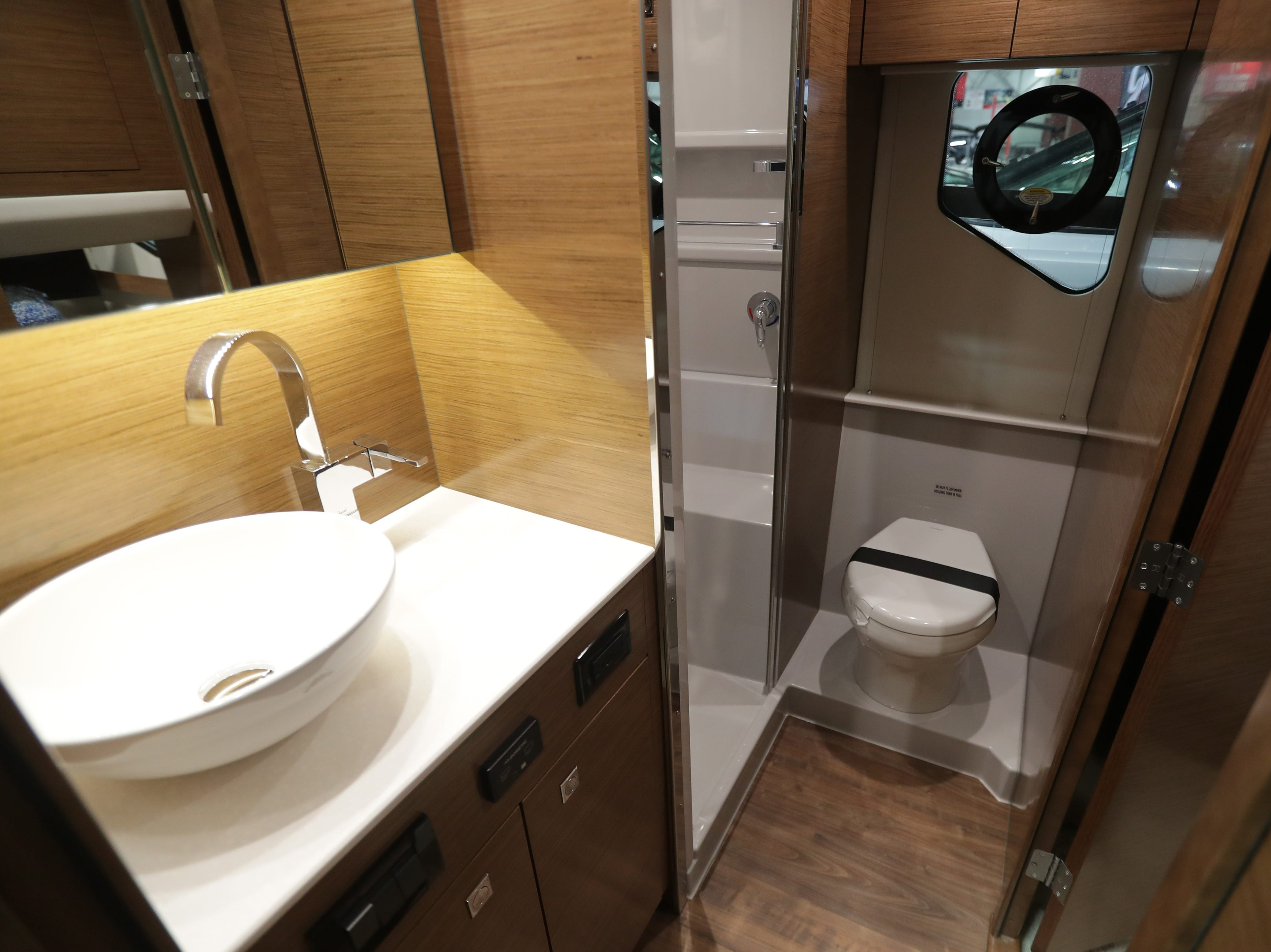 The bathroom of a 2019 42-foot Cruisers Cantius yacht, which lists for $1,022,244.