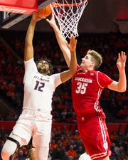 Badgers forward Nate Reuvers blocks the shot attempt of Fighting Illini center Adonis De La Rosa during the first half Wednesday night.