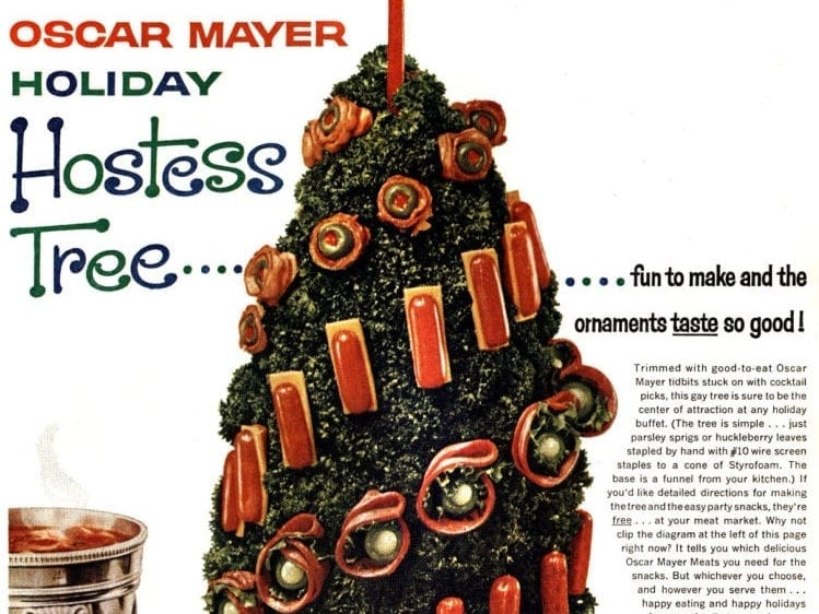 "Oscar-Mayer meat tidbits are stuck onto this parsley- or huckleberry-leaf-covered Styrofoam ""hostess tree"" with toothpicks."