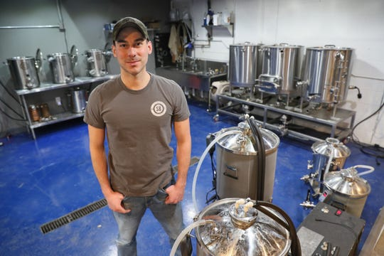 Spike Brewing Equipment owner Ben Caya stands in the test brewery the company uses to test its equipment.