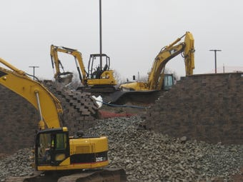 Police and contractors are on the scene of a collapse of a retaining wall fronting a shopping center under construction on Route 46 in Parsippany.
