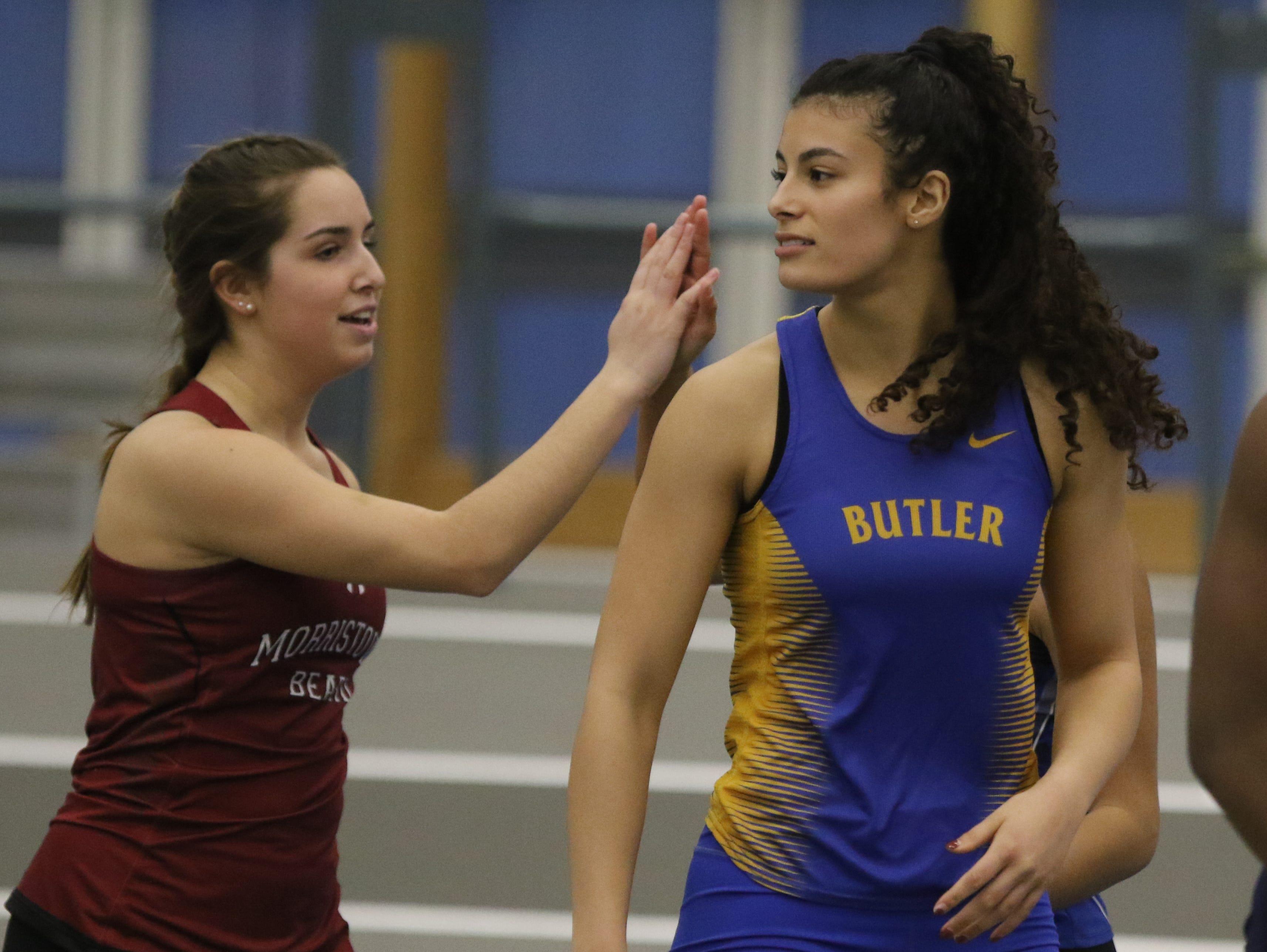 Nicole Borowiec of Morristown Beard congratulates Rebecca Kneppel of Butler after Kneppel won the girls 55 meter dash.
