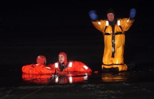 Former Daily Record Editor Meghan Van Dyk is rescued by Budd Lake Rescue Squad 1st Lt. Kevin Perry, left, and Willie Cirone during a drill in February 2013.