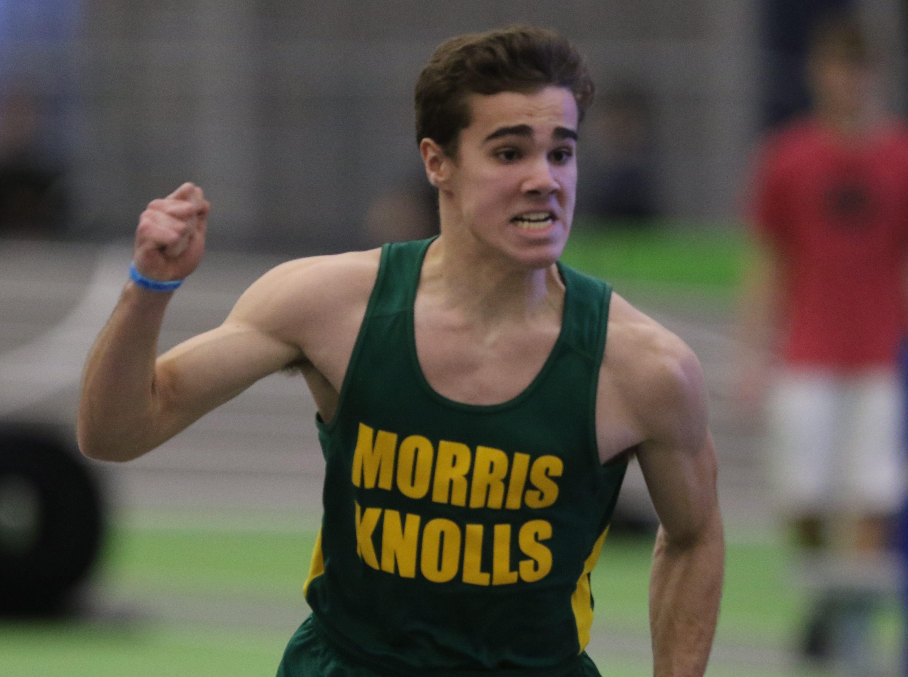 Raul Esteves of Morris Knolls after he wins the boys 55 meter dash.