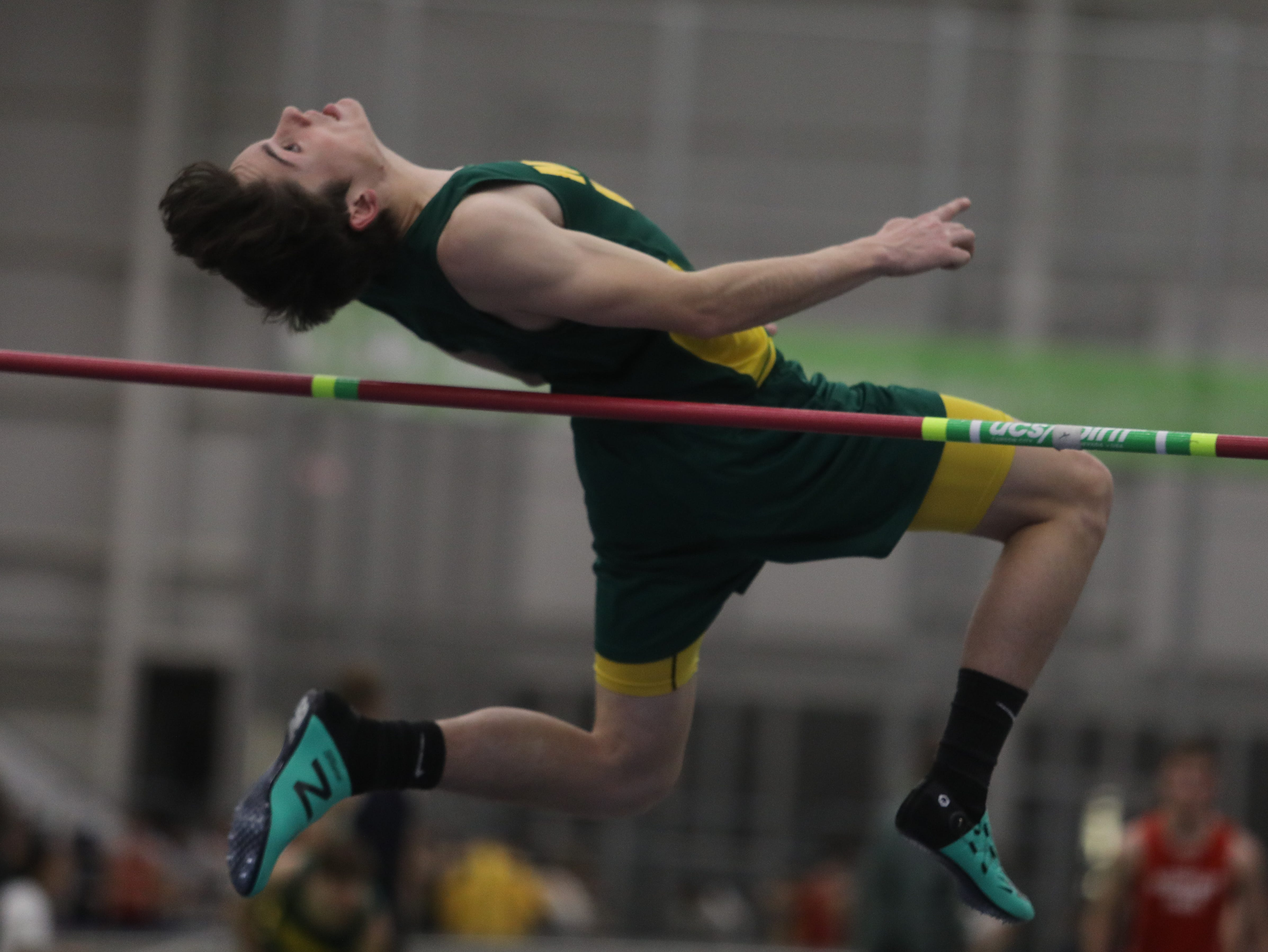 """Nick Boss of Morris Knolls clears the bar at 5'6"""" in the boys high jump."""