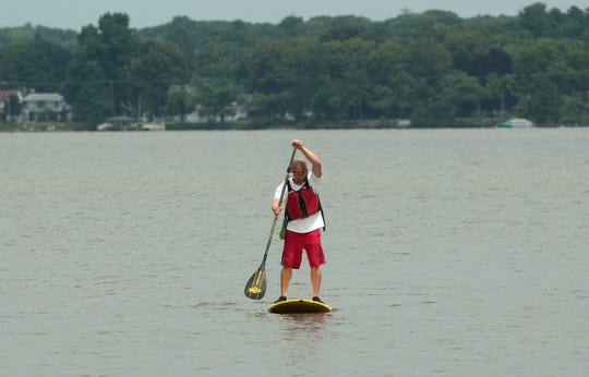 A man paddleboards on Budd Lake  in Mount Olive. July 25, 2014,