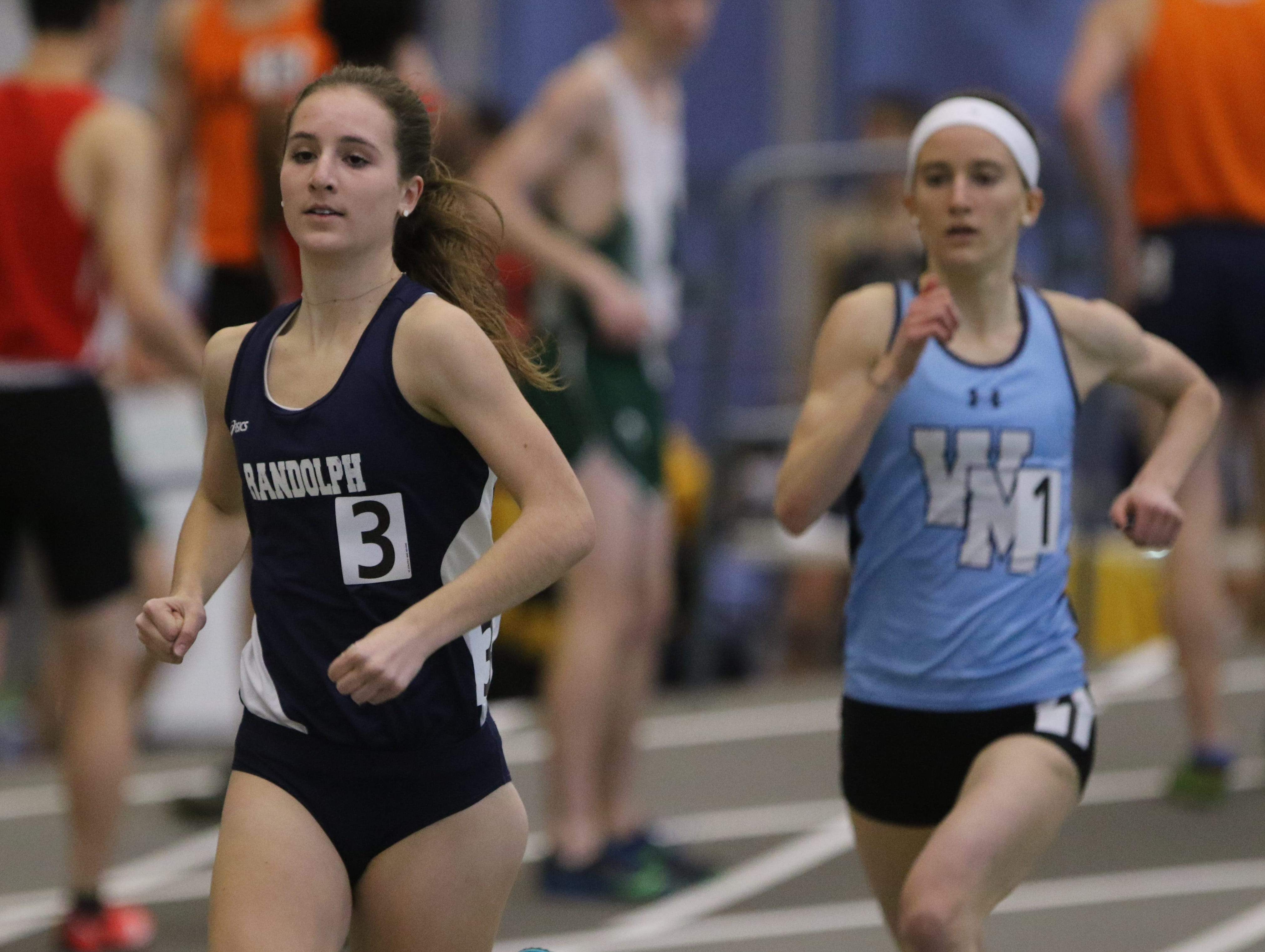 Abby Loveys of Randolph leads Julia Trethaway of West Morris as she wins the girls 1600 meter run.