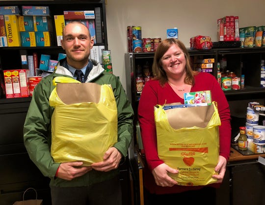 Bryan Coward, recreation supervisor, and Susan Gaeb, clerk to the Department of Community Services, orchestrate a food pantry for federal workers during the government shutdown.