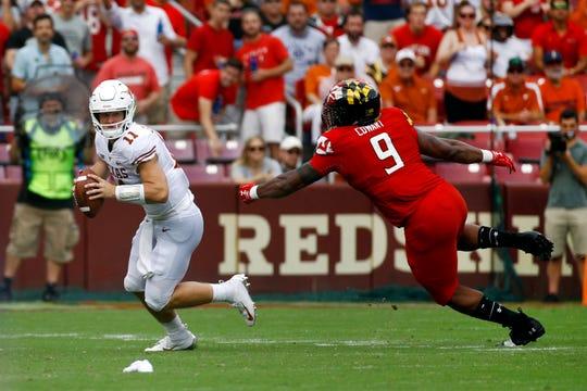 Maryland defensive lineman Byron Cowart )9) chases Texas quarterback Sam Ehlinger (11) on Saturday, Sept. 1, 2018, in Landover, Md.